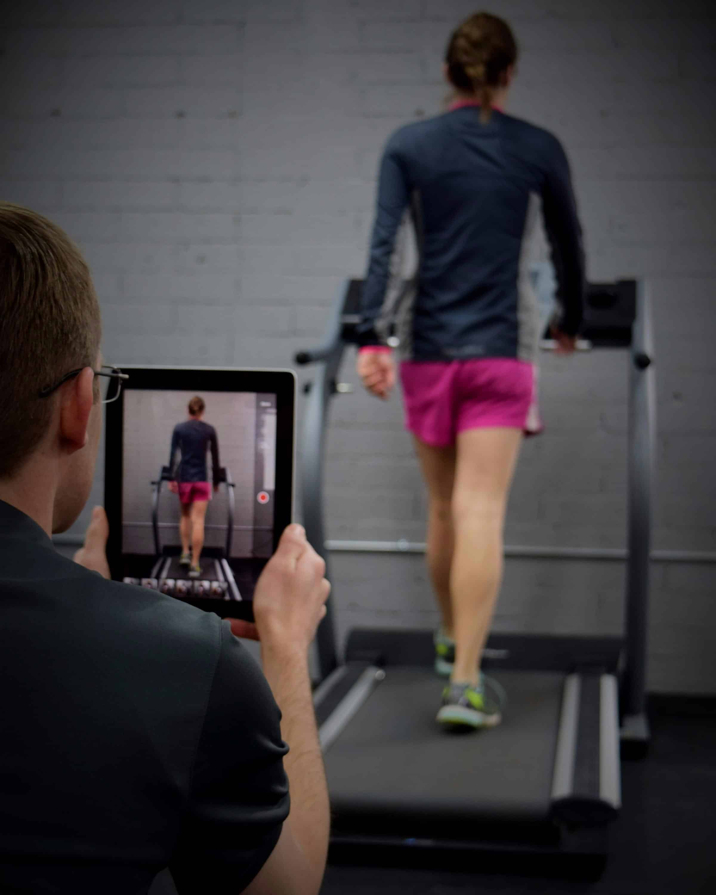 Girl being filmed for gait analysis on treadmill